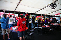 Apr 22, 2017; Baytown, TX, USA; Fans in hospitality tent watch as NHRA top fuel driver Doug Kalitta warms up in the pits during qualifying for the Springnationals at Royal Purple Raceway. Mandatory Credit: Mark J. Rebilas-USA TODAY Sports