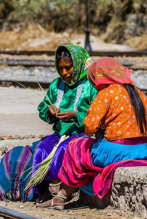 Tarahumara Indian women at the train station at San Rafael selling handwoven baskets, Copper Canyon, Mexico