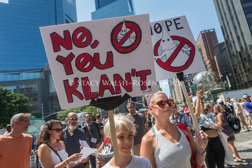 New York, NY 13 August 2017 - Fire & Fury - Anti - trump protesters gathered in Columbus Circle, across from Trump Hotel And Towers, to speakout against President Trump's threats against North Korea, denounce the Alt-right, and remember those killed in Charlottesville, VA. ©Stacy Walsh Rosenstock