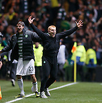 Neil Lennon celebrates on the park as Tony Watt's shot hits the back of the net to make it 2-0