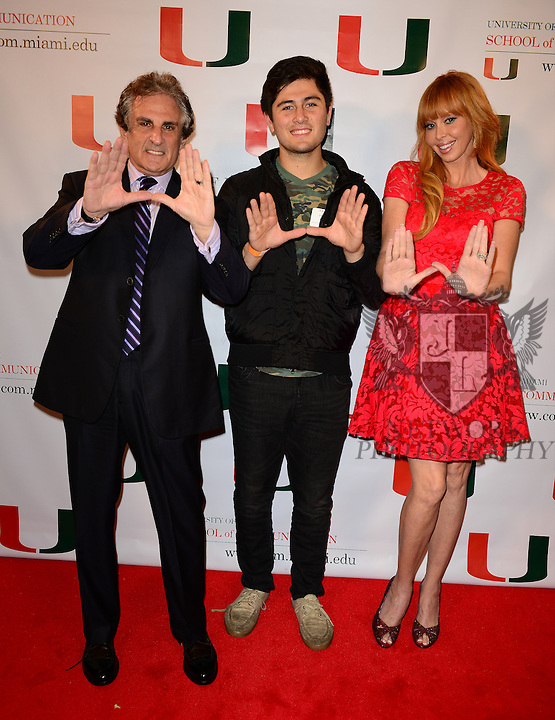 CORAL GABLES, FL - NOVEMBER 20: John Herzfeld, Holland Herzfeld and Rebekah Chaney attend the premiere screening Of 'Reach Me' Hosted by University Of Miami inside the BankUnited Center Fieldhouse at University of Miami on Thursday November 20, 2014 in Coral Gables, Florida. (Photo by Johnny Louis/jlnphotography.com)