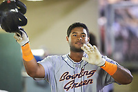 Devin Davis (32) of the Bowling Green Hot Rods gives phantom high fives in the dugout as he teammates give him the silent treatment following his home run against the Dayton Dragons at Fifth Third Field on June 8, 2018 in Dayton, Ohio. The Hot Rods defeated the Dragons 11-4.  (Brian Westerholt/Four Seam Images)