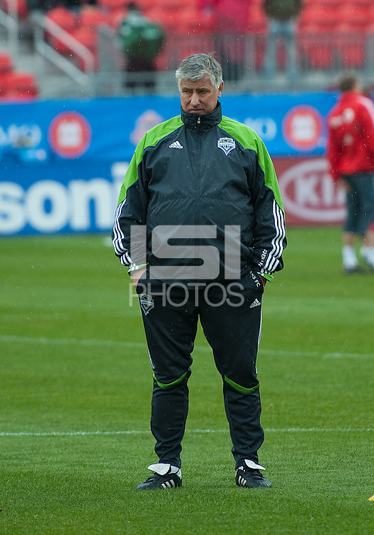25 April 2010:   Seattle Sounders head coach Sigi Schmid checks on his players during the warm-up in a game between the Seattle Sounders and Toronto FC at BMO Field in Toronto..Toronto FC won 2-0....