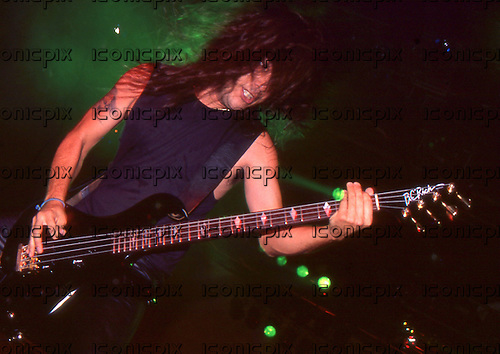Slayer - vocalist Tom Araya - performing live on the Clash of The Titans Tour at Le Zenith in Paris France - 02 Oct 1990.  Photo credit: George Amann/Dalle/IconicPix