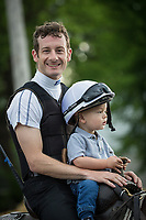LOUISVILLE, KY - APRIL 30: Jockey, Julien Leparoux puts his son Mitchell up on a horse with him for the first time at Churchill Downs on April 30, 2017 in Louisville, Kentucky. (Photo by Alex Evers/Eclipse Sportswire/Getty Images)