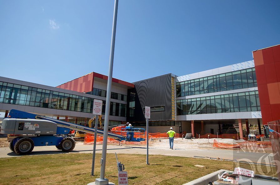 NWA Media/JASON IVESTER --08/21/2014--<br /> Workers continue construction on Thursday, Aug. 21, 2014, at the new Joplin High School in Joplin, Mo. The school was originally scheduled to open with the rest of the school district on Monday, Aug. 25, but was pushed back to Tuesday, Sept. 2.