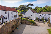 BNPS.co.uk (01202 558833)<br /> Pic: Stags/BNPS<br /> <br /> The holiday cottages which come with the farm.<br />  <br /> Fans of the Famous Five can follow in Julian, Dick, George, Anne and Timmy the dog's footsteps and create their own jolly japes with this idyllic coastal home.<br /> <br /> Widmouth House is perfect for Enid Blyton-style escapism, in a magical location on the north Devon coast with its own private beach, which was used as a filming location for a TV adaptation of one of the books.<br /> <br /> The stunning property, which is on the market with Stags for &pound;2.9million, also has 33 acres of headland and woodland and it's own hamlet of 11 holiday cottages, providing a ready-made business for anyone who wants to swap the rat race for a rural adventure.