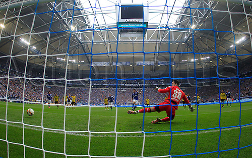 10.04.2016. Gelsenkirchen, Germany.  Schalke's Klaas-Jan Huntelaar (back C)scores the 2-2 penalty goal past Dortmund's goalkeeper Roman Buerki (front C) during the German Bundesliga  match between FCSchalke 04 and Borussia Dortmund at the Veltins Arena in Gelsenkirchen, Germany, 10 April 2016.