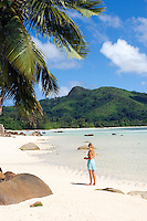 Seychelles, Island Mahe, Anse Boileau: woman at beach, west coast<br />