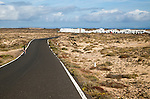 Cyclist on road at Caleta de Caballo village, Lanzarote, Canary islands, Spain