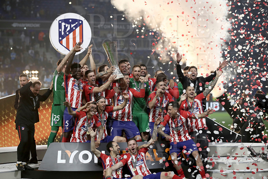 Club Atletico de Madrid's players hold up the trophy at the end of the UEFA Europa League final football match between Olympique de Marseille and Club Atletico de Madrid at the Groupama Stadium in Decines-Charpieu, near Lyon, France, May 16, 2018. Club Atletico de Madrid won 3-0.<br /> UPDATE IMAGES PRESS/Isabella Bonotto