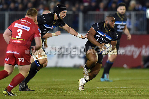 Beno Obano of Bath Rugby in possession. European Rugby Champions Cup match, between Bath Rugby and the Scarlets on January 12, 2018 at the Recreation Ground in Bath, England. Photo by: Patrick Khachfe / Onside Images