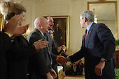 United States President George W. Bush greets guests after calling on Congress to pass an Iraq War spending bill with no timetable for withdrawal in the East Room of the White House in Washington, D.C. on April 16, 2007.      <br /> Credit: Roger L. Wollenberg / Pool via CNP