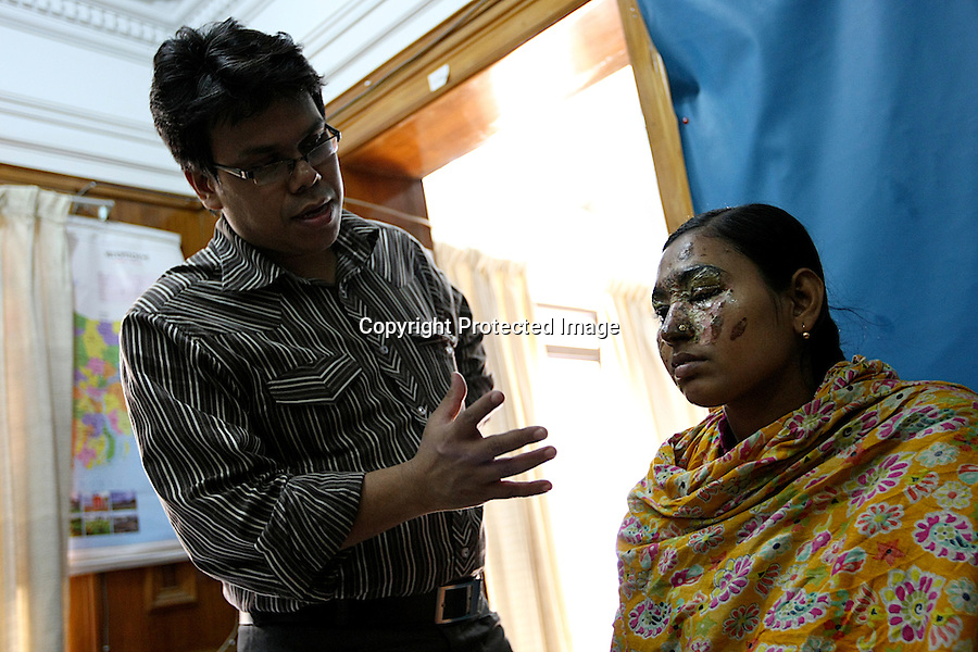 "Dr Imtiaz who has been working at Acid Survivors Foundation since the beginning, is assessing a young woman, Lucky, who has been attacked by acid. About the level of acid violence in Bangladesh, Dr Imtiaz says : ""It has decreased a lot. But the difference is that in some cases the injuries are much more extensive than earlier. It is all pre-planned with masterminds behind and the quantity of acid used is much more. The amount of patients has decreased but the amount of injury incurred has increased""..""You saw some patients at the assessments with all of their backs burnt. It is not 20 miller litres of acid that is thrown on the victim, it is one, two, three litters of acid that they use! This is going up""..Dhaka, Bangladesh - 2009"
