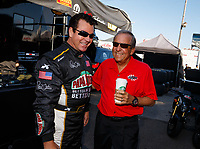 Mar 18, 2017; Gainesville , FL, USA; Papa Johns Pizza founder John Schnatter (left) with team owner Don Schumacher during qualifying for the NHRA Gatornationals at Gainesville Raceway. Mandatory Credit: Mark J. Rebilas-USA TODAY Sports