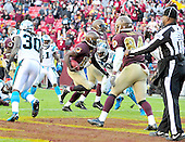Washington Redskins quarterback Robert Griffin III (10) scores a touchdown that was nullified by a holding penalty on center Will Montgomery (not pictured) in the fourth quarter against the Carolina Panthers at FedEx Field in Landover, Maryland on Sunday, November 4, 2012.  The Panthers won the game 21 - 13..Credit: Ron Sachs / CNP