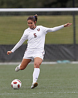 Harvard University midfielder Aisha Price (5) clears the ball. In overtime, Harvard University defeated Yale University,1-0, at Soldiers Field Soccer Stadium, on September 29, 2012.