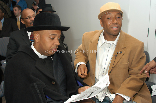 WWW.ACEPIXS.COM . . . . . ....NEW YORK, DECEMBER 14, 2004....Reverend Run and Russell Simmons at the passing of a reform on the Rockefeller drug laws held at the Governor's office in NYC.....Please byline: ACE006 - ACE PICTURES.. . . . . . ..Ace Pictures, Inc:  ..Alecsey Boldeskul (646) 267-6913 ..Philip Vaughan (646) 769-0430..e-mail: info@acepixs.com..web: http://www.acepixs.com