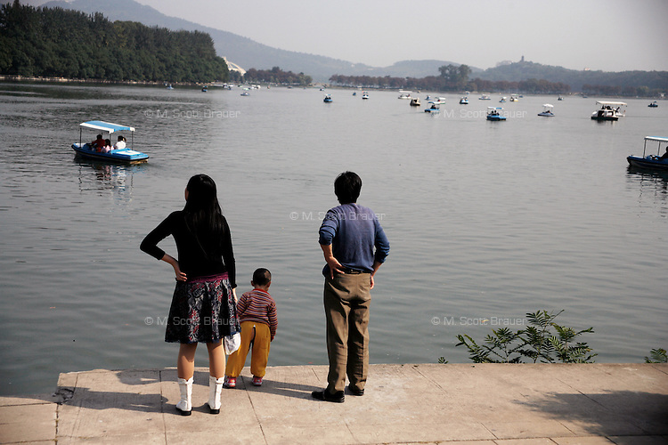 A family looks out over Xuanwu Lake in Nanjing, China.