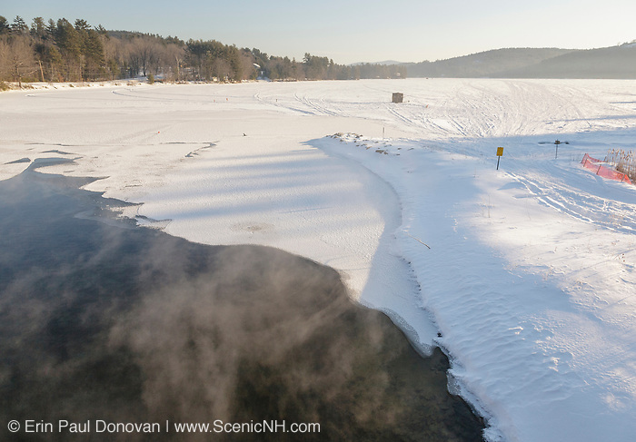 Winter fog over Squam Lake in Ashland, New Hampshire USA during the winter months