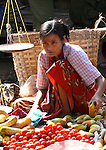 Woman selling vegetables at market in Inle Lake