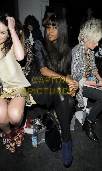 VV Brown (Vanessa Brown) .attended the Basso & Brooke Spring/Summer 2012 catwalk show, London Fashion Week Day 1, Old Sorting Office, New Oxford St., London, 16th September 2011..LFW full length backstage sitting  black leather patch tights blue suede ankle boots .CAP/CAN.©Can Nguyen/Capital Pictures.