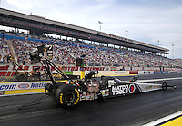 Apr 10, 2015; Las Vegas, NV, USA; NHRA top fuel driver Antron Brown (near lane) races alongside Tony Schumacher during qualifying for the Summitracing.com Nationals at The Strip at Las Vegas Motor Speedway. Mandatory Credit: Mark J. Rebilas-