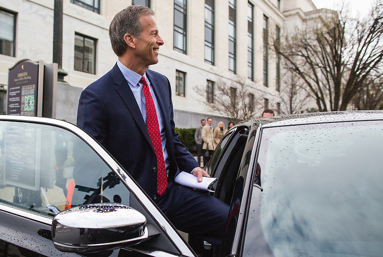 UNITED STATES - MARCH 15 - Sen. John Thune, R-S.D., prepares to ride in the 2014 Chrysler 300c, during an exhibition of self-driving cars for the Senate Committee on Commerce, Science, and Transportation, on Capitol Hill, in Washington, on Tuesday, March 15, 2016. (Photo By Al Drago/CQ Roll Call)