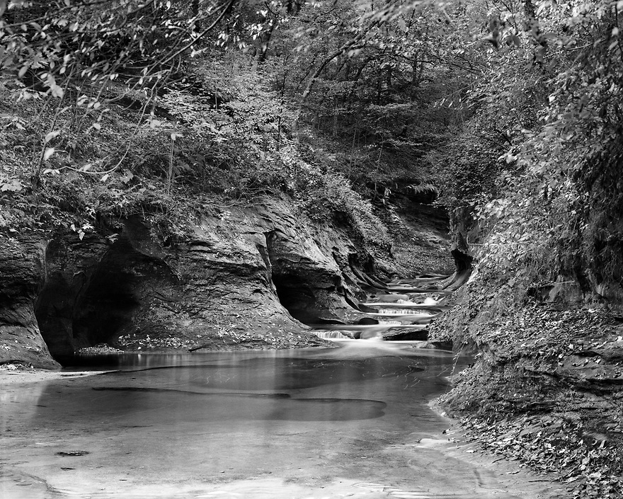 """Fall Creek Gorge Nature Preserve in rural Warren County is under the protection of the Nature Conservancy.  Most local people refer to the place as """"The Potholes."""" The flowing waters of Fall Creek constantly carve into the sandstone, creating steep walled canyons and potholes as it flows toward Big Pine Creek.  The short trail leads around the area for a pleasant hike in the woods."""
