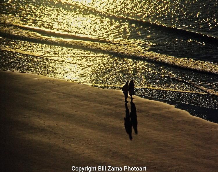 Beach strollers at sunrise on Myrtle Beach, SC.