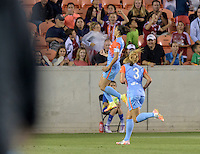 Houston, TX - Saturday April 16, 2016: Houston Dash midfielder Carli Lloyd (10)  celebrates scoring during a National Women's Soccer League (NWSL) match against the Chicago Red Stars at BBVA Compass Stadium.