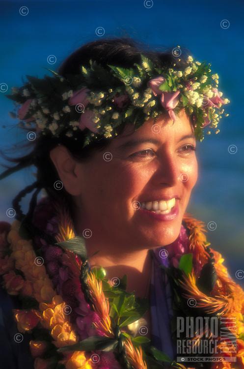 Portrait of a Hawaiian woman adorned in flower leis