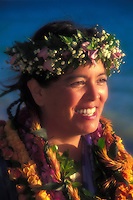 Portrait of a Hawaiian woman adorned in flower leis