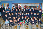 MID-KERRY: The teachers and students of Castledrum NS, Keel welcoming the Mid-Kerry stars Kieran Foley, Gary Sayers and Aaron Cahillane with the Bishop Moriarty Cup at their school on Tuesday.   Copyright Kerry's Eye 2008