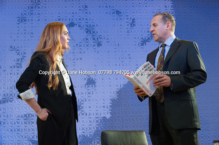 "London, UK. 30.09.2014. ""Speed-the-Plow"", by David Mamet, directed by Lindsay Posner, starring Lindsay Lohan, opens at the Playhouse Theatre. Picture shows: Lindsay Lohan (Karen) and Nigel Lindsay (Charlie Fox). Photograph © Jane Hobson."