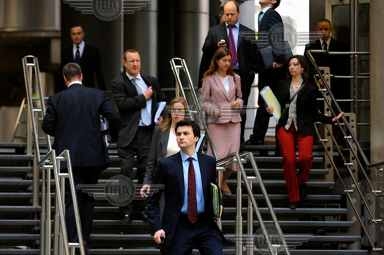 People coming out of Lloyds Tower in the City of London.