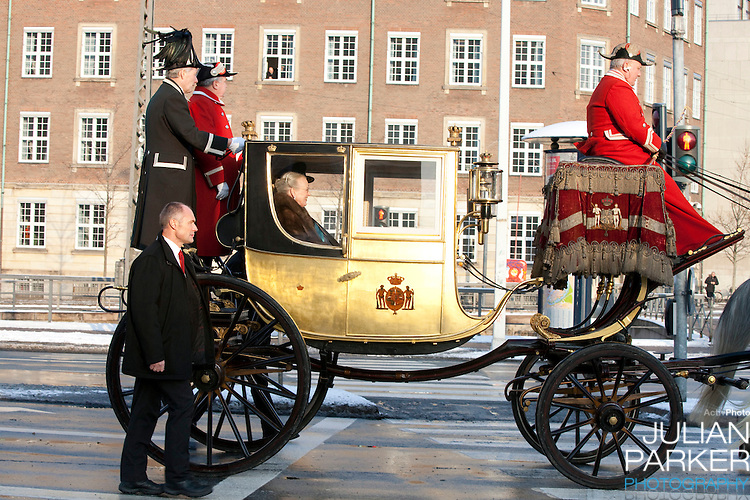 Queen Margrethe, and Prince Henrik of Denmark leave Christiansborg Palace, in Copenhagen, Denmark, in The Golden Carriage after attending the Grand New Years Court.
