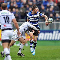 Matt Banahan offloads the ball after being tackled. Amlin Challenge Cup quarter-final, between Bath Rugby and CA Brive on April 6, 2014 at the Recreation Ground in Bath, England. Photo by: Patrick Khachfe / Onside Images