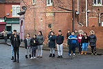 © Joel Goodman - 07973 332324 . 20/01/2018. Doncaster, UK. People from Hexthorpe watch as far-right street protest movement , the English Defence League ( EDL ) , march through the town , opposed by anti-fascists , including Unite Against Fascism ( UAF ) in the Hexthorpe area of Doncaster . EDL supporters chanted anti-Roma slogans as they marched through the town . Photo credit : Joel Goodman