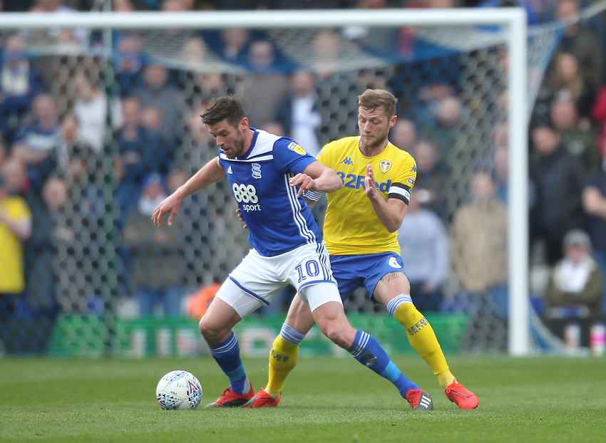 Leeds United's Liam Cooper in action with Birmingham City's Lukas Jutkiewicz<br /> <br /> Photographer Mick Walker/CameraSport<br /> <br /> The EFL Sky Bet Championship - Birmingham City v Leeds United - Saturday 6th April 2019 - St Andrew's - Birmingham<br /> <br /> World Copyright © 2019 CameraSport. All rights reserved. 43 Linden Ave. Countesthorpe. Leicester. England. LE8 5PG - Tel: +44 (0) 116 277 4147 - admin@camerasport.com - www.camerasport.com