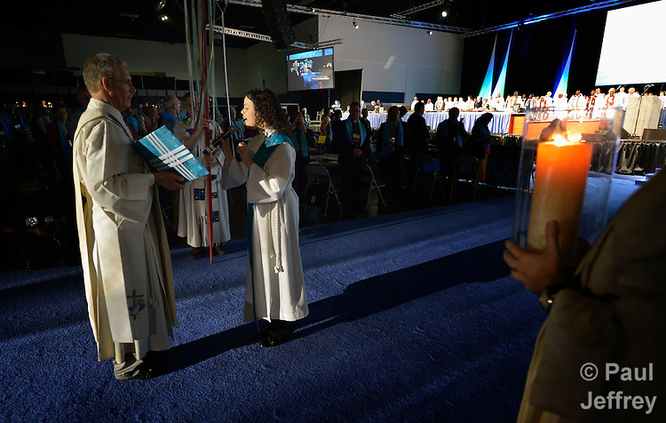 A woman reads the scripture lesson during the April 24 opening worship service of the 2012 United Methodist General Conference in Tampa, Florida.