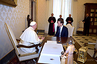 Pope Francis talks with Austrian Chancellor Sebastian Kurz, left, during their private audience at the Vatican, Monday, March 5, 2018.