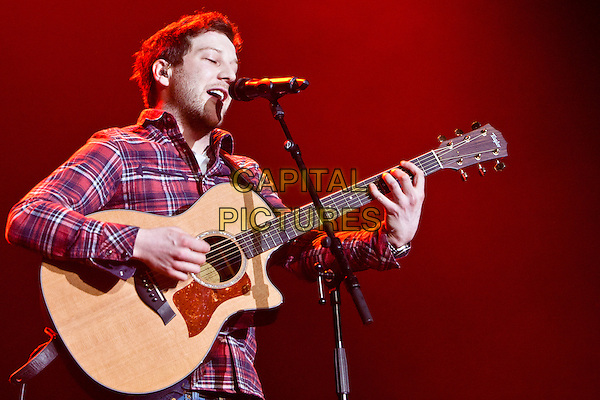 Matt Cardle .Girlguiding UK Big Gig at LG Arena, Birmingham, England..March 31st 2012.on stage in concert live gig performance performing music half length red black check plaid tartan shirt singing guitar .CAP/PP/MM.©Mike Mustard/PP/Capital Pictures.