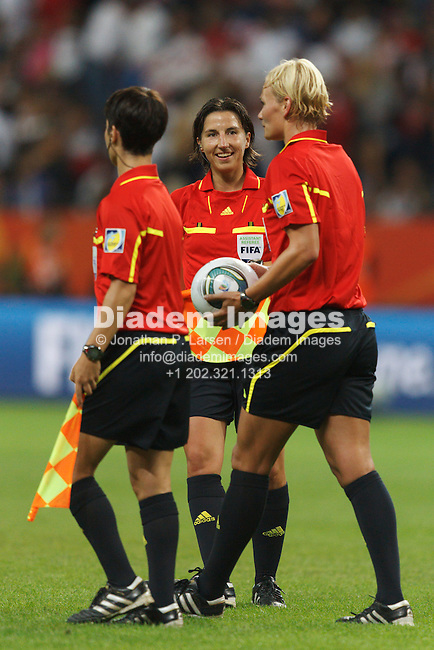 FRANKFURT, GERMANY - JULY 17:  The FIFA officiating team leaves the field at the end of regulation play of the Women's World Cup final between the United States and Japan at FIFA Women's World Cup Stadium on July 17, 2011 in Frankfurt, Germany.  Editorial use only.  Commercial use prohibited.  No push to mobile device usage.  (Photograph by Jonathan P. Larsen)