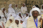 Israel, Jerusalem, Ethiopian Orthodox pilgrims at Deir es Sultan by the dome of St. Helena Chapel at the Church of the Holy Sepulchre on Maundy Thursday, Easter