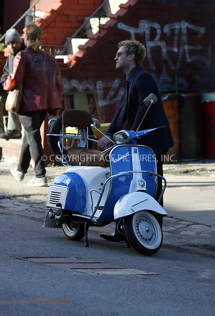 Jude Law riding a Vespa on the set of 'Alfie' which is currently filming in New York City. November 20 2003. Please byline: NY Photo Press.   ..*PAY-PER-USE*      ....NY Photo Press:  ..phone (646) 267-6913;   ..e-mail: info@nyphotopress.com