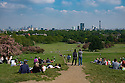 People enjoy the sun and the view from the top of Primrose Hill, North London, on a sunny May Bank Holiday weekend.