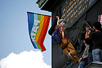 Gay rights protestor on the Colonne de Juillet, May Day March, Paris, 1 May 2009