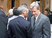 Washington, DC - March 4, 2009 -- Rahm Emanuel, White House Chief of Staff, talks with United States Senator Max Baucus (Democrat of Montana), Chairman, Senate Finance Committee, at  a dinner for Congressional  Committee chairmen and ranking members in the East Room of the White House on Wednesday, March 4, 2009. .Credit: Dennis Brack - Pool via CNP