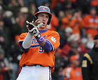 Right fielder Steven Duggar (9) of the Clemson Tigers claps his hands to celebrate scoring the team's first run in the second inning of a game against the South Carolina Gamecocks on Saturday, March 2, 2013, at Fluor Field at the West End in Greenville, South Carolina. Clemson won the Reedy River Rivalry game 6-3. (Tom Priddy/Four Seam Images)